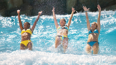 Girls back dive wave pool