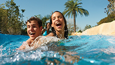 Teens splashing lazy river Aquatica San Diego